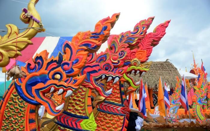 Ornamented carriers of Buddha images for annual Chak Phra Festival
