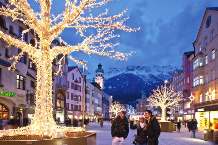 Visitors looking at a decorations on Christmas eve in Innsbruck