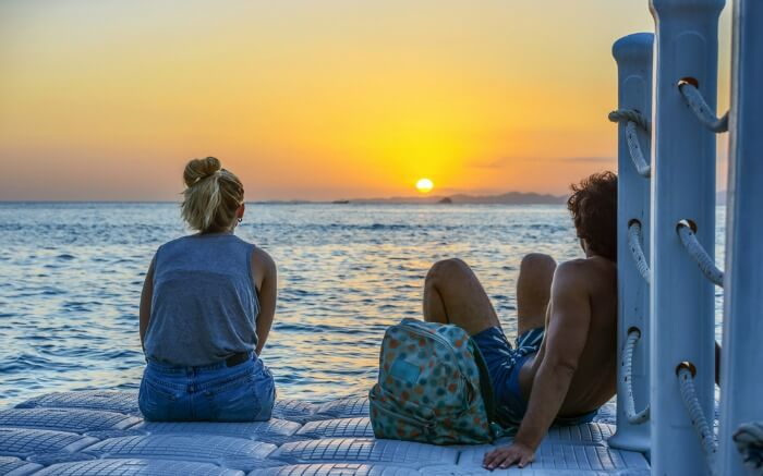 Couple looking at sunset in Krabi