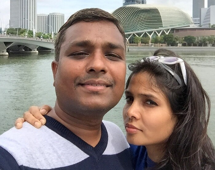 Govind takes a selfie with his wife in Singapore
