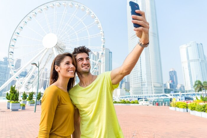 A couple takes selfie on a honeymoon in Hong Kong