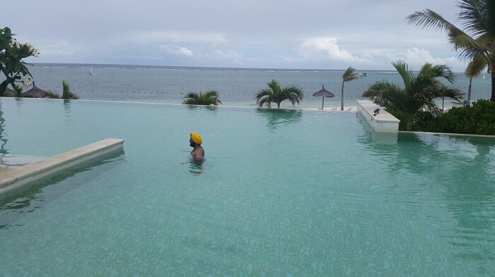 Man enjoying inside infinity pool