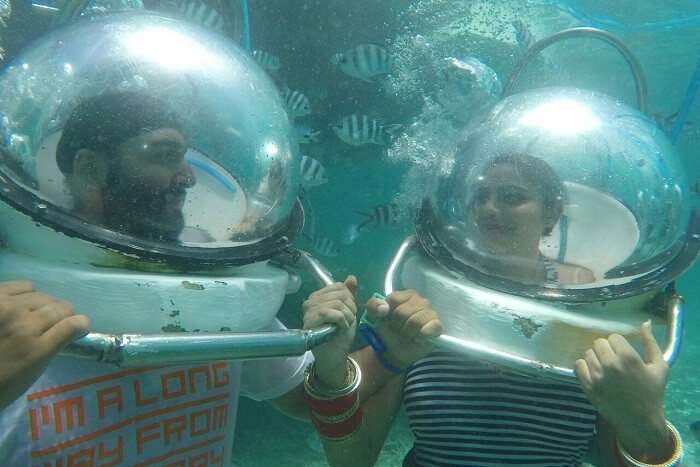 couple enjoying underwater seawalking