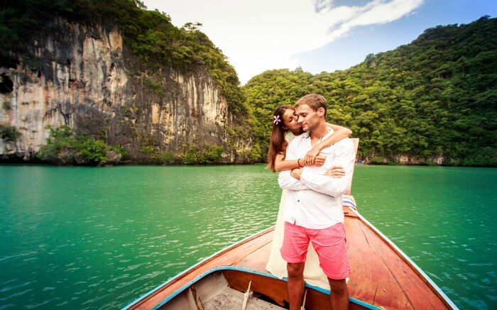 Couple posing on a tail boat in Krabi
