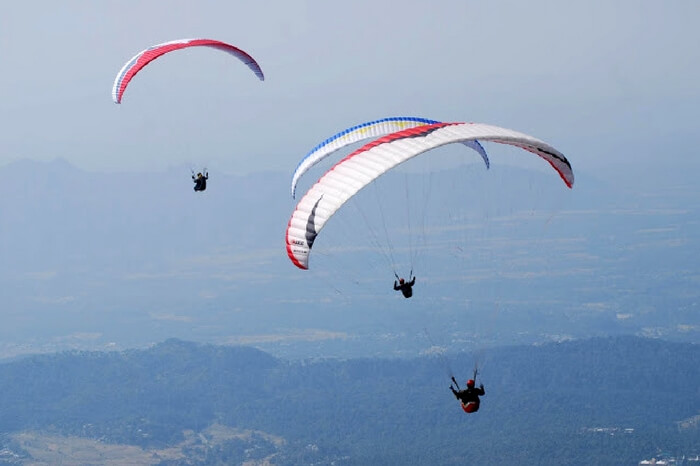 Paragliders enjoying paragliding in Khajjiar