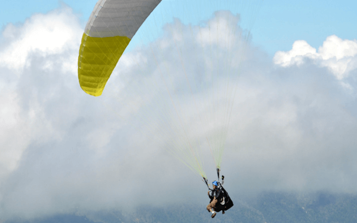 A person paragliding- which is one of the best things to do in Mukteshwar