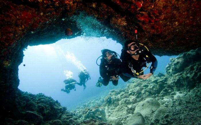 Couples scuba diving in Krabi