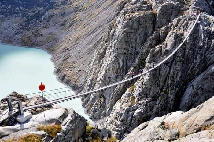 An aerial view of Trift Bridge in Switzerland