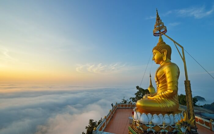 Tiger Cave Temple surrounded by clouds - a must-visit on your honeymoon in Krabi