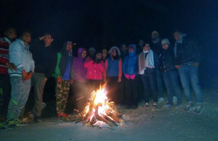 tejal & group enjoying a bonfire at triund
