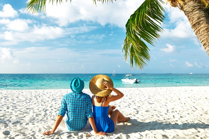 A couple relaxing on a beach in Mauritius
