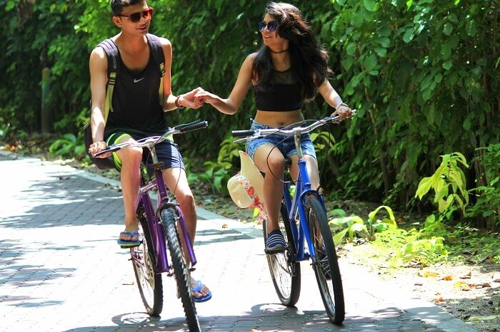 Nisarg and his wife cycling at the Sun Island Resort in Maldives