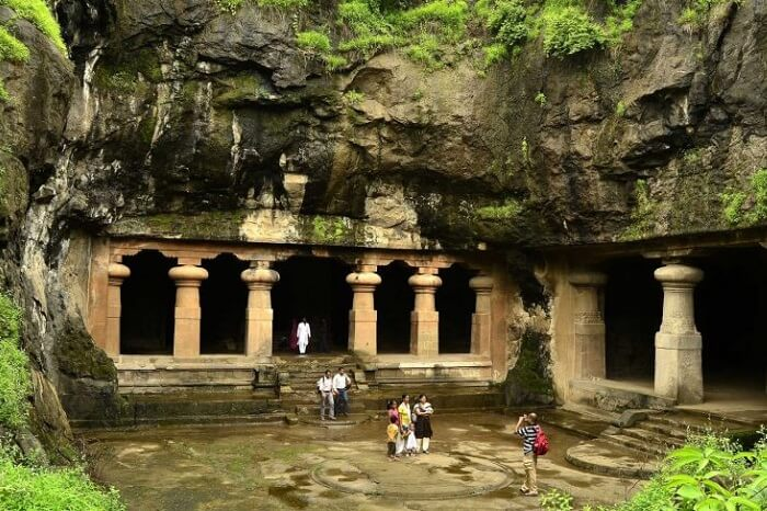 Tourists clicking photographs at the entrance to the Elephanta Caves on the island near Mumbai