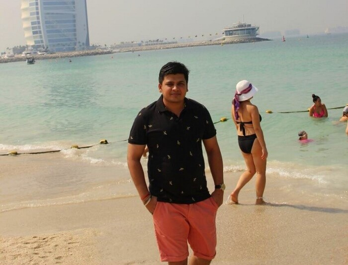 Parag on a beach in Dubai