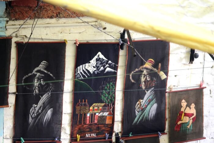 tejal checking out paintings in mcleodganj market