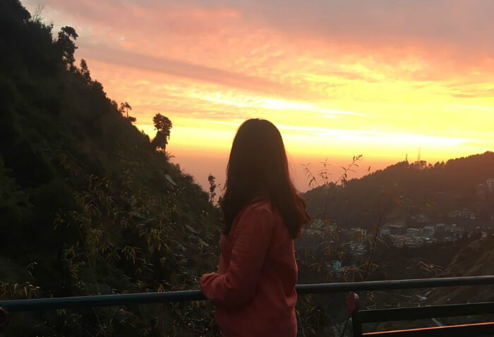 tejal watching sunset from shiva cafe