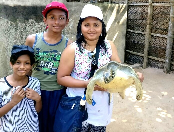 Family in turtle hatchery