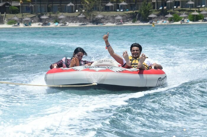 Couple enjoying speed boat ride in Mauritius