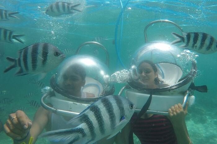 Couple enjoying Underwater Seawalking in Mauritius