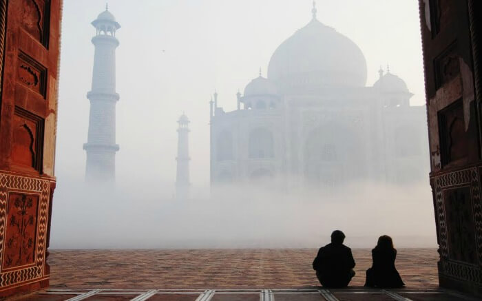 Couple gazing at Taj Mahal at sunrise