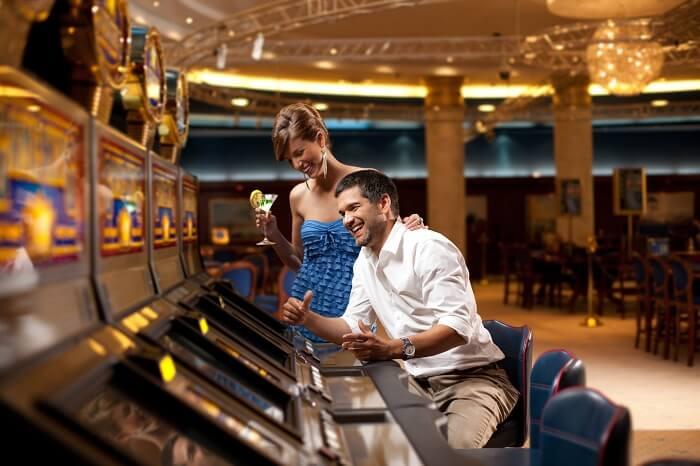 Romantic couple enjoying at a casino on honeymoon