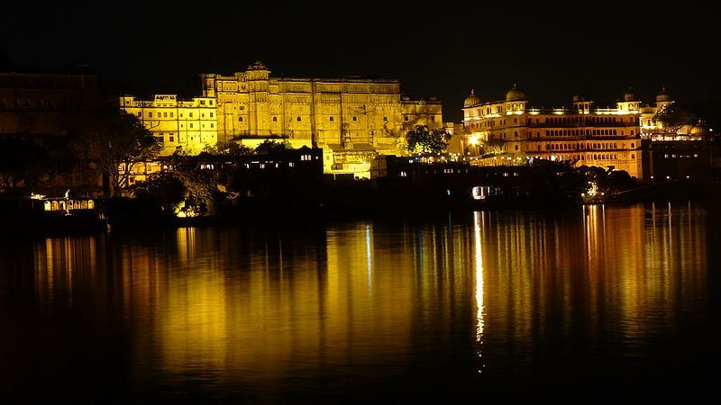 reflection of a palace on lake water at night