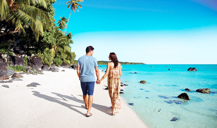 Couple walking on the beach in Cooks Islands