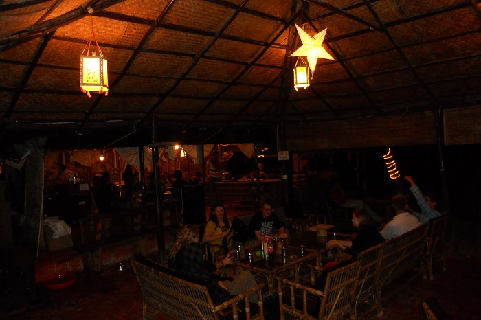 Tourists and locals enjoying drinks and food at the Full Moon Cafe on Havelock Island