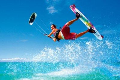 A honeymooner trying surf boarding on a beach in Sri Lanka