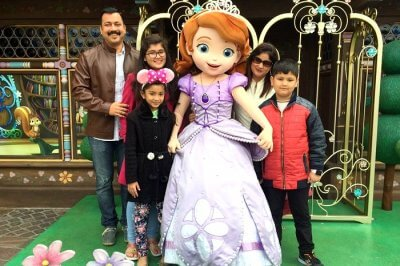 Vivek and his family in Disneyland Hong Kong