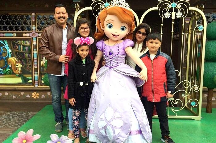 Vivek and his family in Disneyland Hong Kong