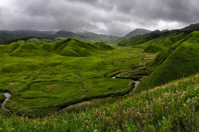 Dzukou Valley near Manipur & Nagaland border with clouds hovering over it