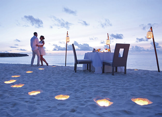 Romantic honeymoon couple in Maldives