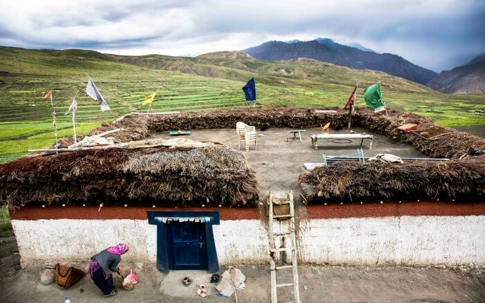 Local woman doing chores in Spiti