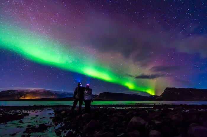Couple enjoying a romantic night full of stargazing