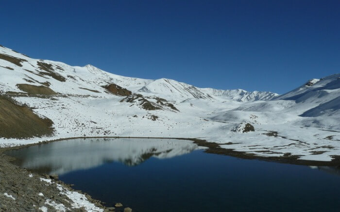 Suraj Tal Lake in Spiti with snow around