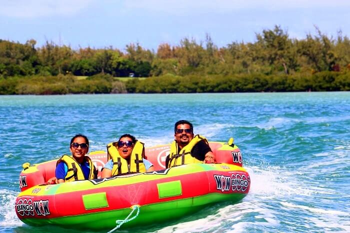 Sandeep and his friends doing the boat ride at Ile aux Cerfs island