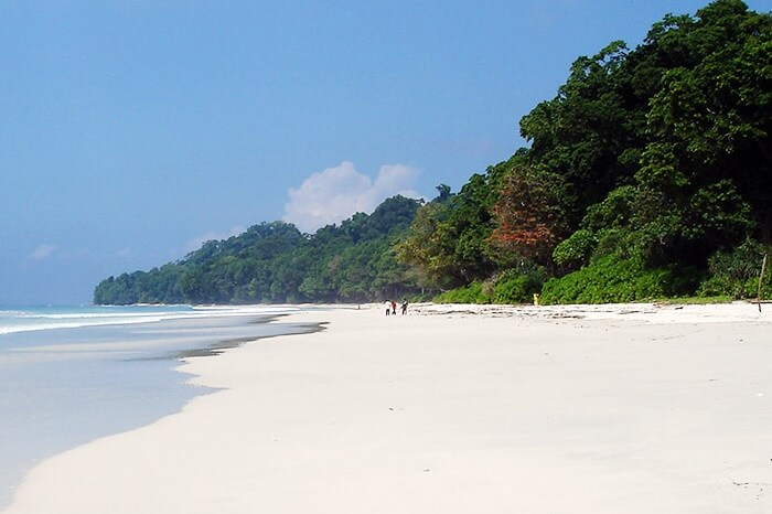 Tourists walking on the beautiful white-sand Radhanagar Beach on Havelock Island