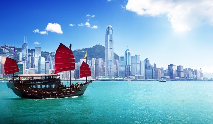 Boat cruises through Harbor City Hong Kong