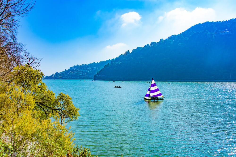 a sailboat in naini lake