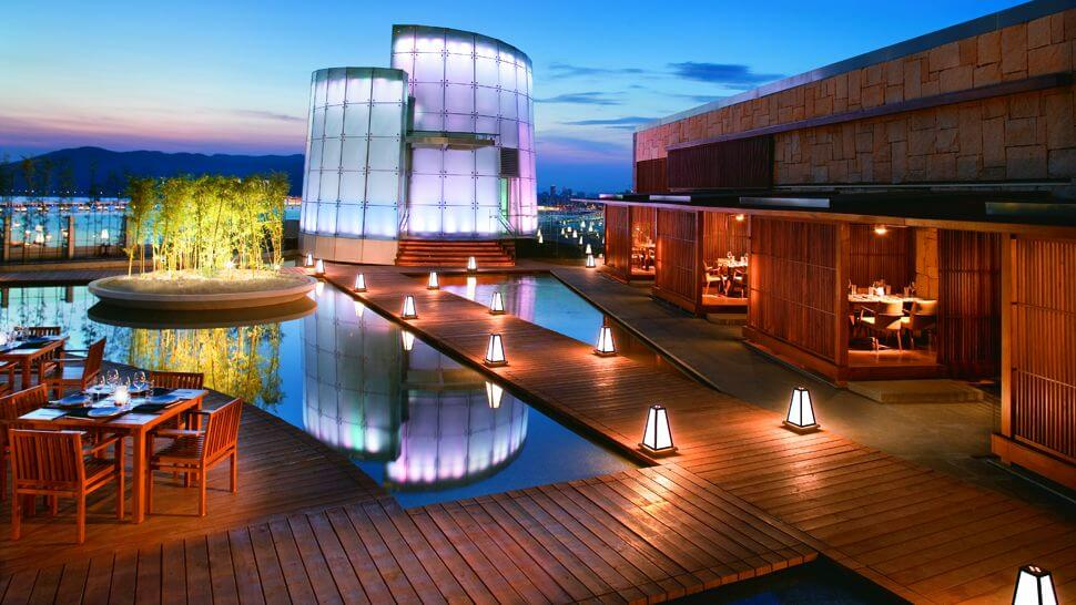 rooftop restaurant surrounded with artificial ponds