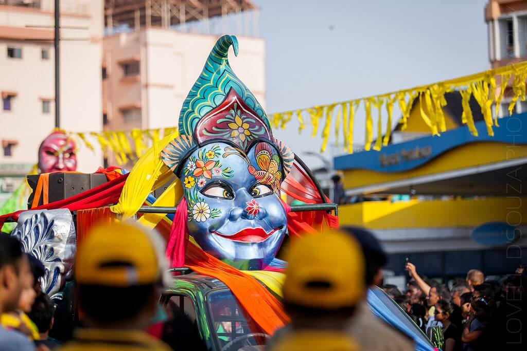 a big mask during float parade in Goa carnival