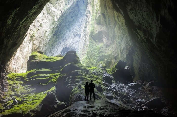 Honeymoon couple caving in Portugal