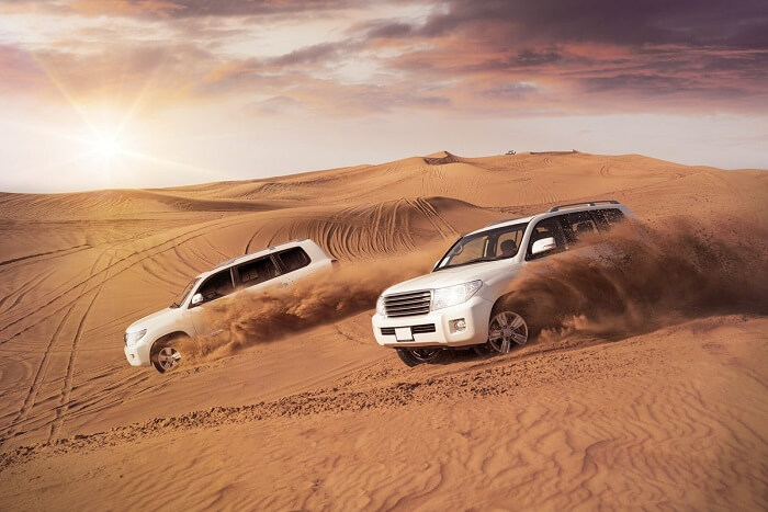 Honeymoon couple dune bashing in Dubai