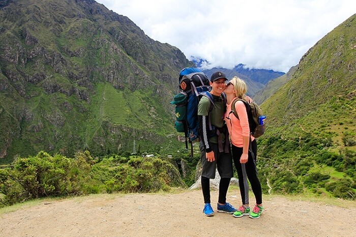 Romantic couple trekking on honeymoon
