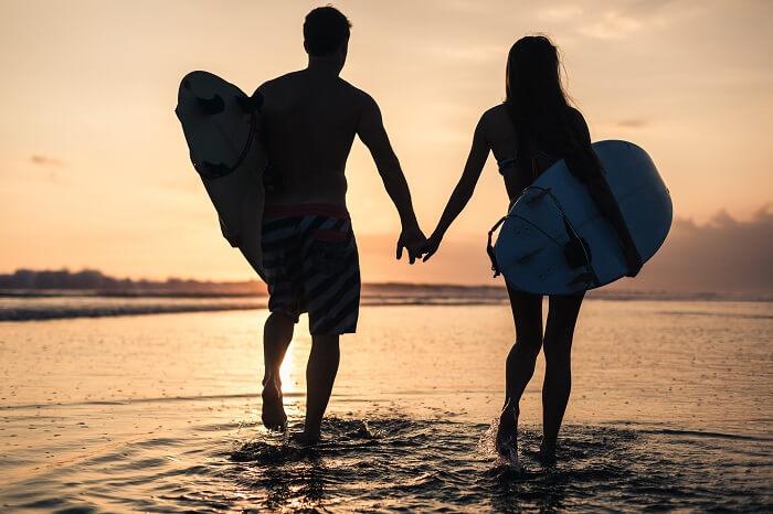 Romantic couple surfing in Uluwatu