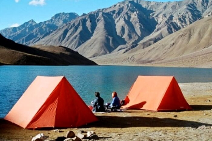 Travelers camping by Chandratal lake in Spiti