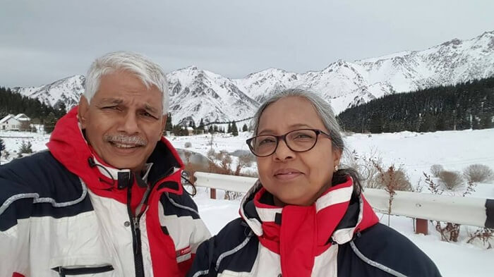 retired couple enjoy snowfall