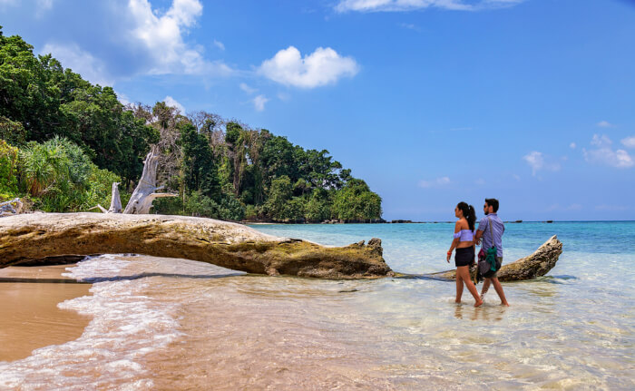 Couple walking on the sea shore in Andamans