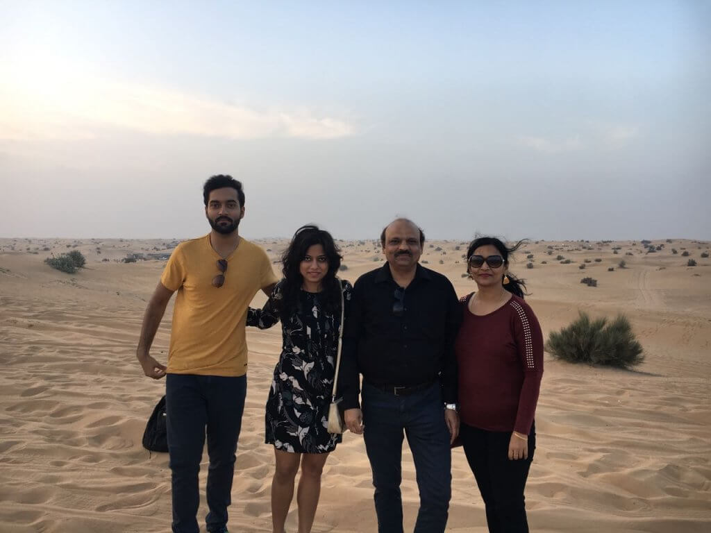 Family in Dubai sand dunes